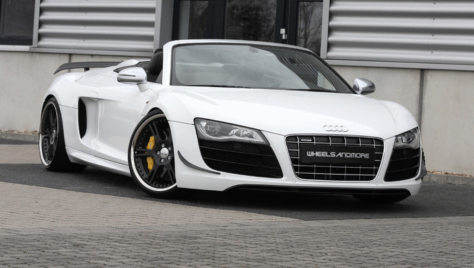 The Audi R8 Spyder first appeared with the 5.2-liter Lamborghini-derived V-10. Although more power is always nice, it shipped with a $161,000 price tag, a nearly $50,000 premium over the base R8 (but only $15,000 more than the R8 5.2 FSI Coupe). To bring the drop-top experience to more people, Audi is adding another model to the R8 lineup. The R8 4.2 FSI Spyder produces 430 hp and launches the open-top two-seater to 62 mph in 4.8 seconds on its way to a top speed of 186 mph. It will also come at a less expensive cost to the consumer. The 10-hp jump from the 2010 4.2 FSI Coupe is actually a change made for all the V-8-engine R8 derivatives for 2011. Like the coupe, the Spyder's engine is mated to the R tronic sequential manual or a six-speed manual transmission; Quattro permanent all-wheel drive is standard.  Audi offers the R8 Spyder 4.2 FSI Quattro with a choice of three colors for the top: black, red, and brown. The soft top weighs approximately 93 pounds and helps keeps the vehicle's weight and center of gravity low. The body is available in the solid finishes Ibis White and Brilliant Red; the metallic finishes Suzuka Gray, Teak Brown, Ice Silver, Jet Blue and Aurum Beige; and the pearl effect finishes Daytona Gray, Sepang Blue, Lava Gray and Phantom Black. The windshield frame is coated with anodized aluminum.