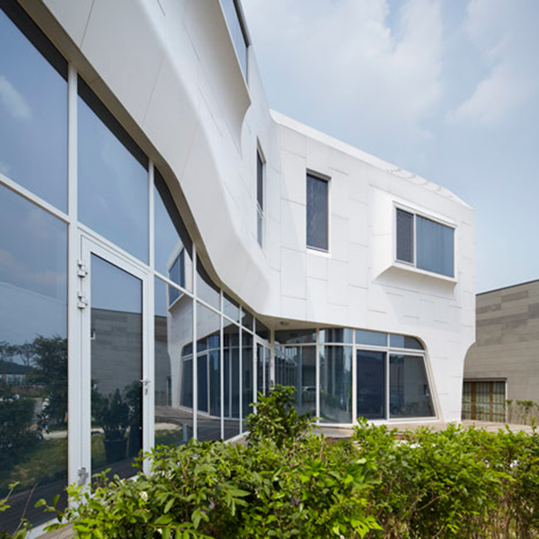 Smooth Details1 Curvy Eccentric White Residence With Square Perforations