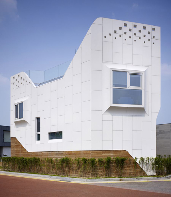 House View Curvy Eccentric White Residence With Square Perforations