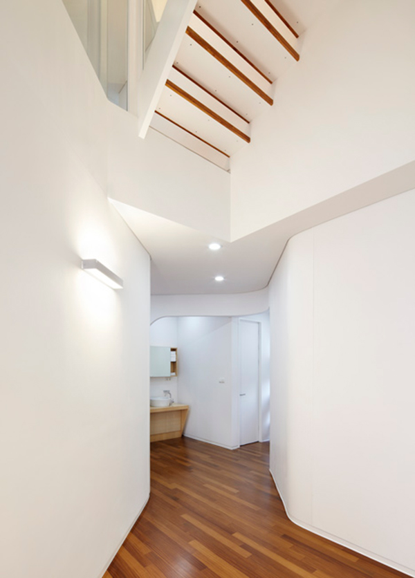 Narrow Hallway Curvy Eccentric White Residence With Square Perforations